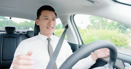 business asian man experience to riding an autonomous self driving car