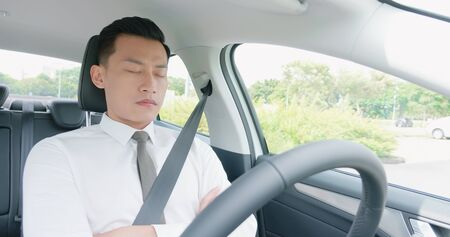 business asian man sleep in an autonomous self driving car