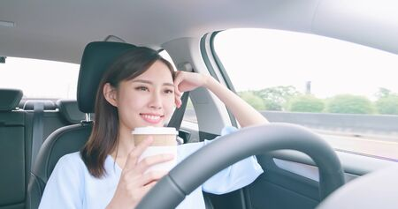 relaxed woman experience to riding an autonomous self driving car and drink a coffee