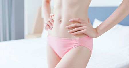 closeup of beauty asian sexy slim woman body at home Reklamní fotografie
