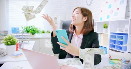 asian business woman excited with raining money