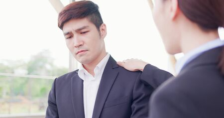 Business asian woman consoles her colleague in the office