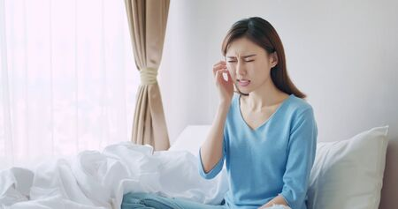 asian beauty woman has dry skin and scratching her face