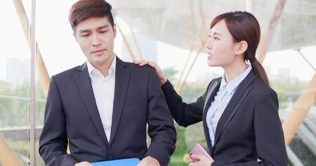 Asian business asian woman consoles her colleague in the office