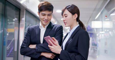 Asian business people use smart phone on the mrt platform