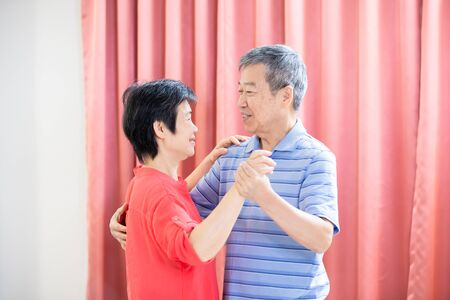 asian eldely couple dance together happily at home Standard-Bild - 131538094