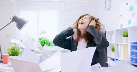 Business asian woman stressed and overworked yelling in office with rainy documents Stock fotó
