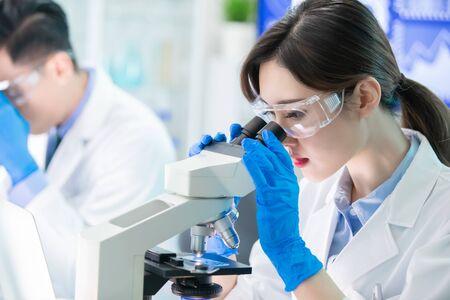 close up of asian scientist team use microscope in the laboratory Zdjęcie Seryjne