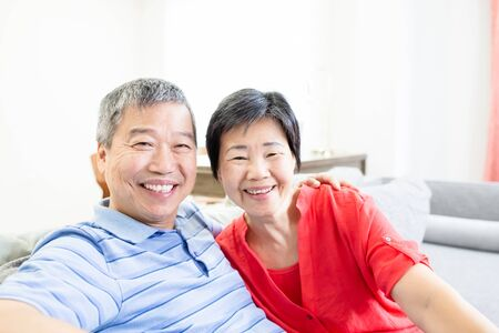 asian eldely couple smile to you happily at home Stok Fotoğraf