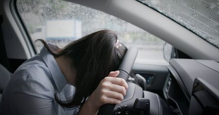 asian woman feel tired and depressed in the car
