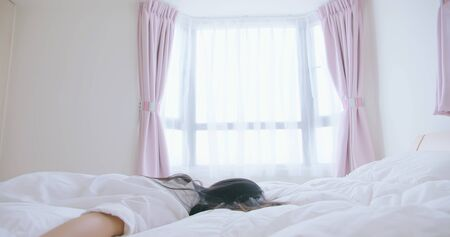 woman feel tired and lying on bed at home