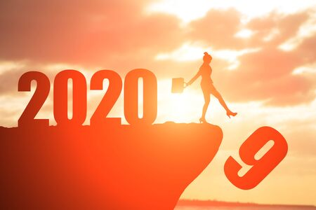 silhouette of businesswoman on the moutain with 2020 Stock Photo