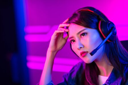 young asian girl gamer lose in Online Video Game and feel depress 版權商用圖片