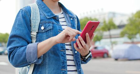 close up of asian young woman use 5g smartphone on the street