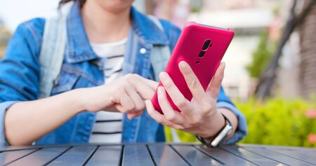 asian young woman use 5g smartphone outdoor