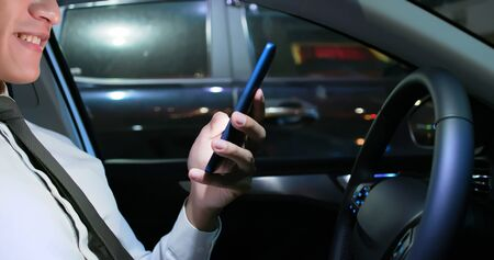 close up of asian businessman use smartphone in the car