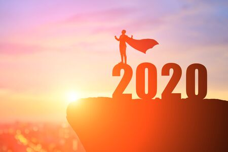 silhouette of businessman feel excited with 2020 on the mountain 版權商用圖片