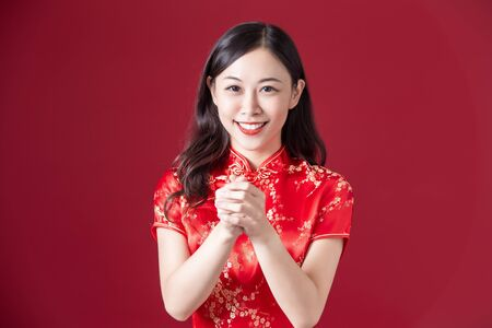 asian woman wearing cheongsam congrate happy chinese new year to you