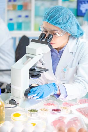 asian scientist team conduct experiment about food in the laboratory