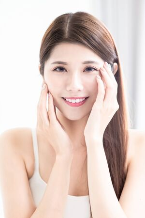 young asian skin care beauty touch her face and look to you with smile