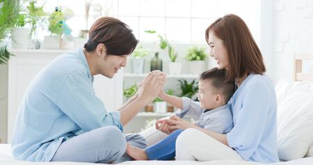 Young parent play with child happily at home
