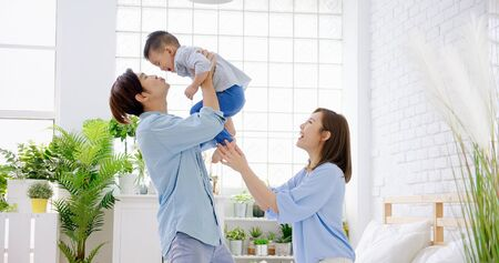 happy family with child boy play and kiss at home