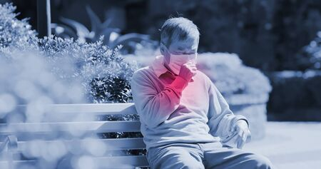 old asian man wear mask and get a cold and cough outdoor because of transmissible infectious diseases or air pollution