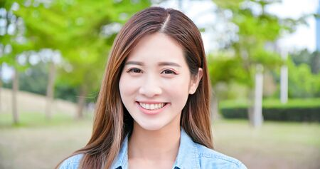 Asian young woman smile to you outdoor Stock fotó