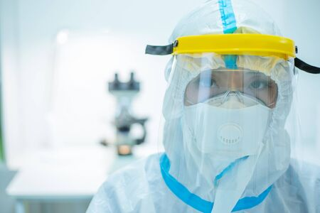 Doctor woman wear the isolation gown or protective suits and surgical face masks