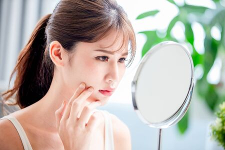 close up of asian woman feel sad because her skin is very oily on face Banque d'images