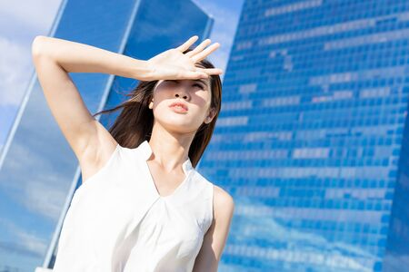 Asian woman afraid of suntan in the summer