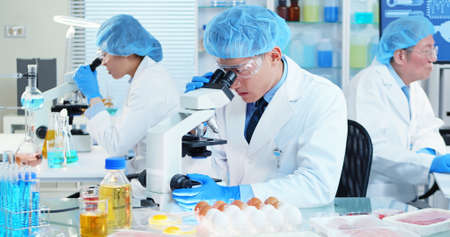 asian scientist team has researching about food safety in the laboratory