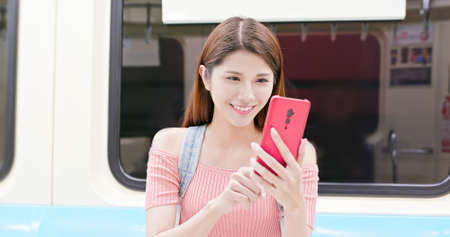 asian young woman use 5g smartphone on the train Stock Photo