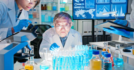 asian scientist team meeting and writing analysis results in the laboratory Stock Photo