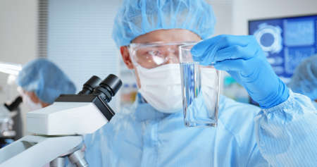 asian scientist team conduct experiment about water safety in the laboratory