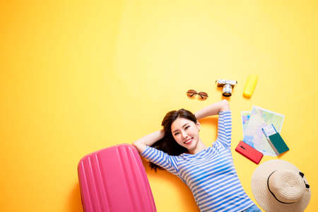 beauty woman smile happily and lying on yellow floor Stock Photo