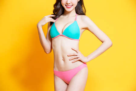 asian woman has good body shape with bikini swimsuit Stock Photo