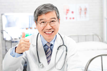 asian male senior doctor smile to you with thumb up gesture