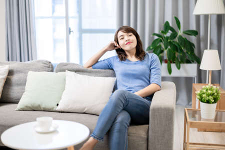 Asian woman take a deep breath and feel peaceful Stock Photo