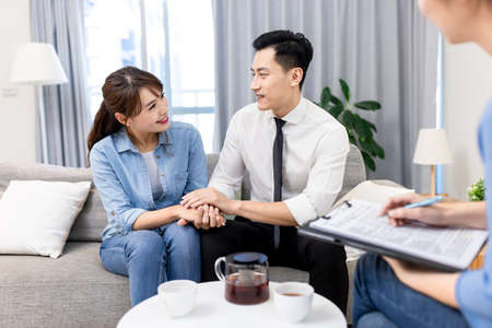 Young asian couple recover their relationship during marital therapy with counselor