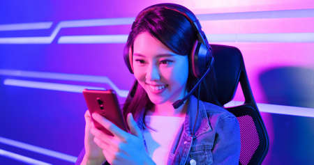Young asian esport gamer girl feel painful while playing in Online Video Game because her shoulder is tired