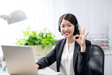 asian customer service representative working in the office