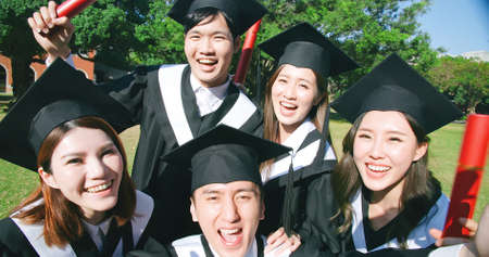 group happy graduate students use mobile phone to take picture together