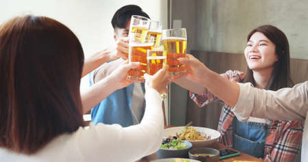slow motion of group of asian happy friends toasting beer in restaurant Stock Photo