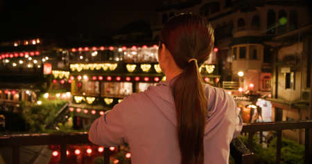 Asian female tourist is traveling at Jiufen old village of Taiwan in the evening