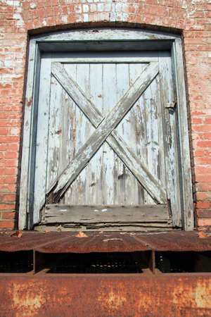 Weathered door that has overpowering robustness Stock Photo