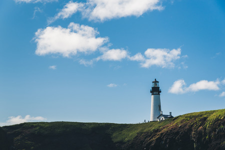A lighthouse overlooking the ocean. Stock Photo