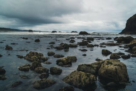 Beach boulders on a cloudy day.