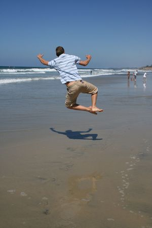 airborn: Man Jumping for joy on beach