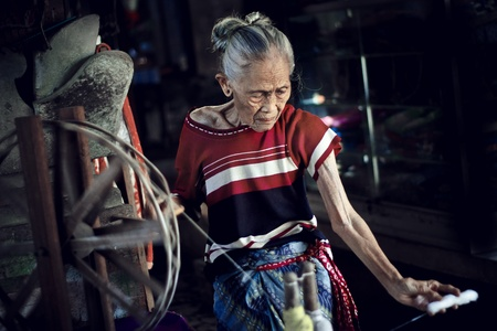 weave: Indonesian woman weaving Stock Photo
